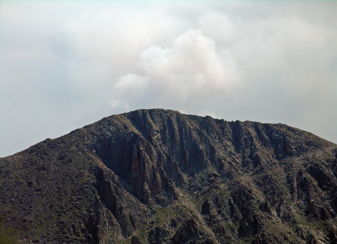 Close up of the smoke from the Colorado High Park Fire rising from Behind Mummy Mountain