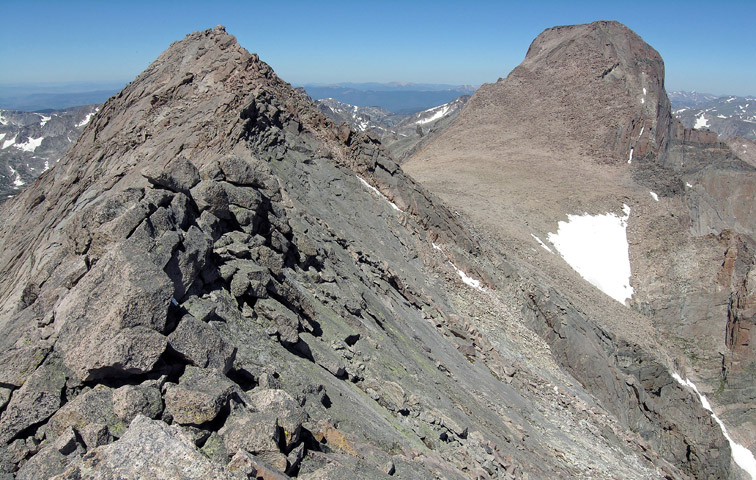 Looking at the exposed upper ridge of Mount Meeker towards the summit block