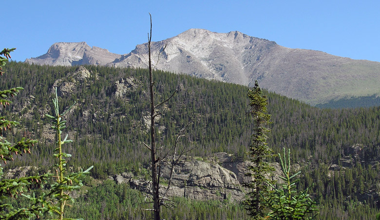 Clear morning view of Longs Peak and Mount Meeker from the Wild Basin trail to Bluebird Lake