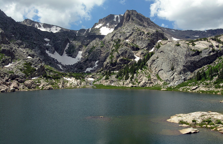 View across Bluebird Lake at the east face of Ouzel Peak in the Wild Basin
