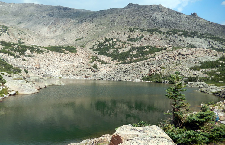 Emmaline Lake with ridge leading up to Comanche Peak in the background