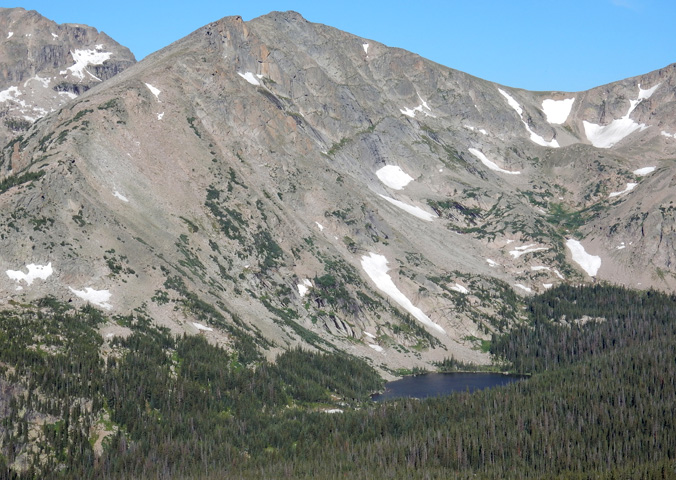 View of Thunder Lake up against Tanima Peak from near the summit of Mount Orton
