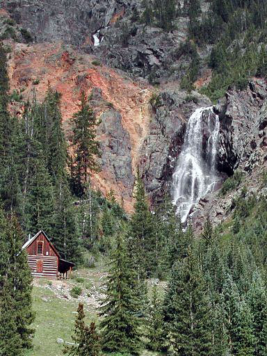 Old mining cabin next to a beautiful waterfall, west of a mining guost town, Animas Forks