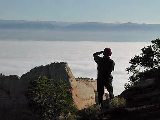 Ben photographing from the camp area with a low cloud covering the ground