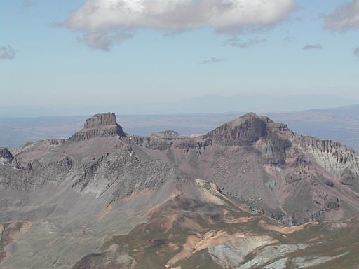 Coxcomb and Redcliff Peaks, both 13,000 foot peaks, as seen looking west from the summit of Uncompahgre Peak