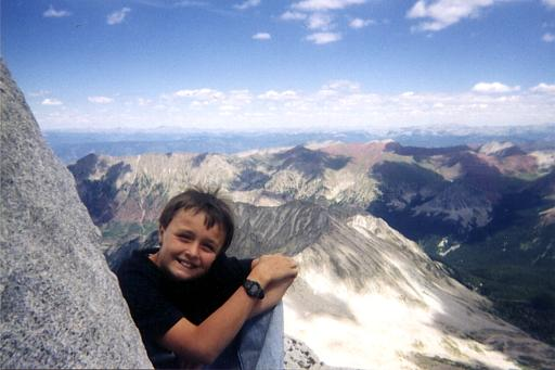 My son, Steve, smiling on top of Snowmass Mountain