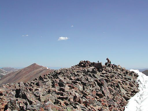 Top of Sunshine Peak with Red Cloud in the background