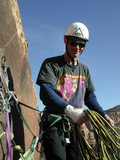 Ben ready to throw the rope, starting the rappel down Otto's Route, Monument Rock, Colorado National Monument