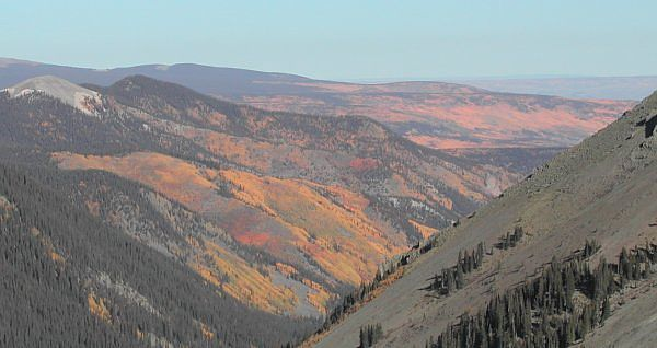 Above treline, looking down at the magnificent autumn colors created by all the aspen groves around San Luis Peak.