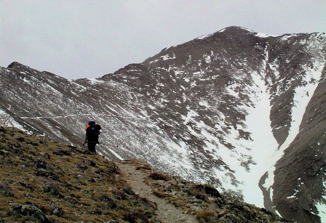 Suzy, at around 12,000 feet, ascending Mount Princeton via the East Slopes Route on an extremely gloomy winter day