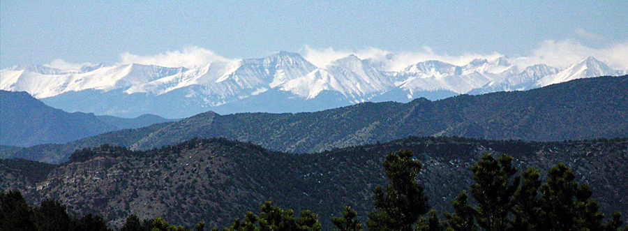 View of snow-capped Sangre de Cristo mountains from Bank area parking, Shelf Road
